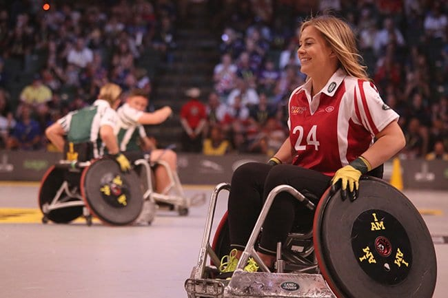 smiling competing in a wheelchair competition