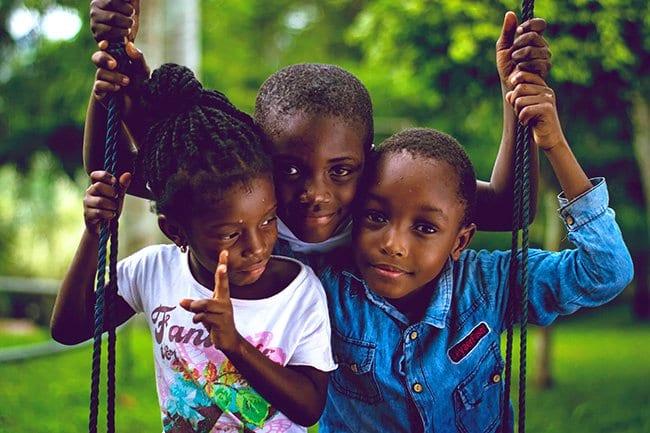 3 siblings on a swing – brain injury