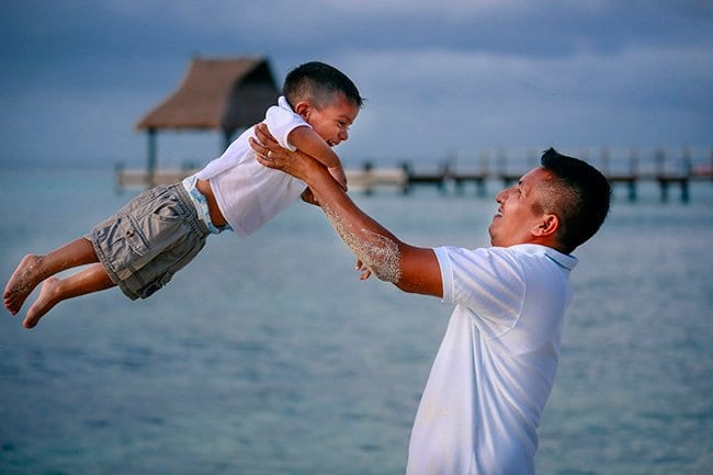 Happy father and son by the ocean
